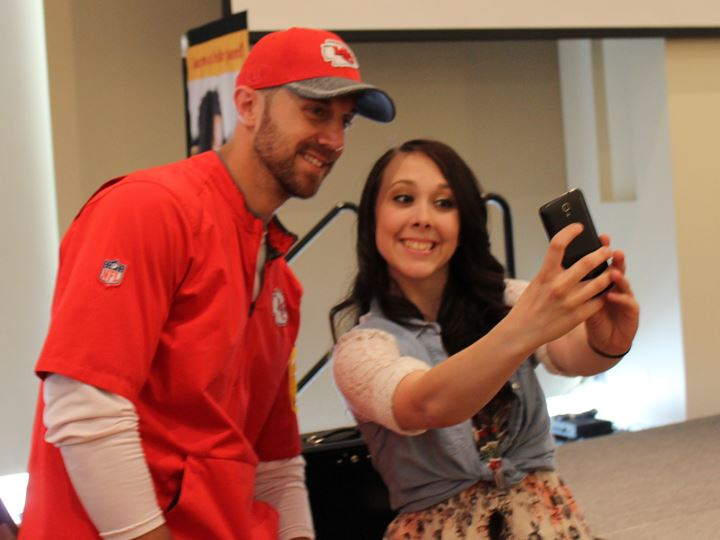 Alex Smith taking a selfie with a foster care youth.