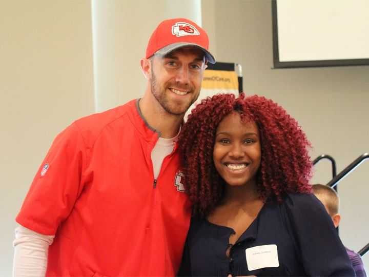 Alex Smith posing with a recent YES graduate.